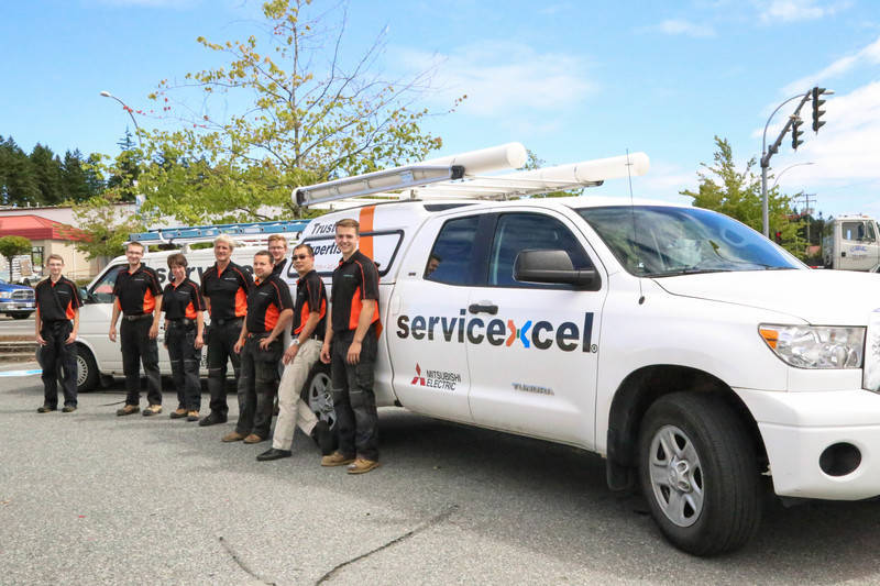 technicians in front of servicexcel truck