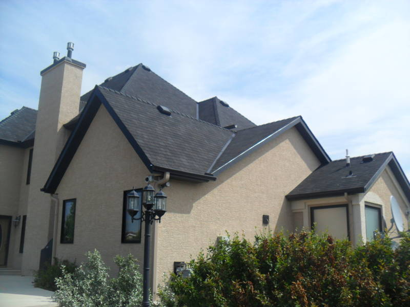 Shingle Roofing with High Profile Raised Ridge Cap
