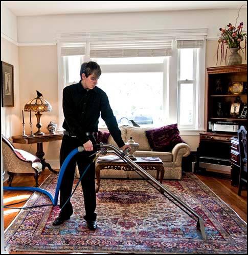 Andrew Salo, third generation in our Family Business, cleans a Persian rug in home. We also offer pick up and delivery service!