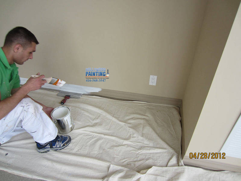 Mississauga painters carefully painting baseboards and condo