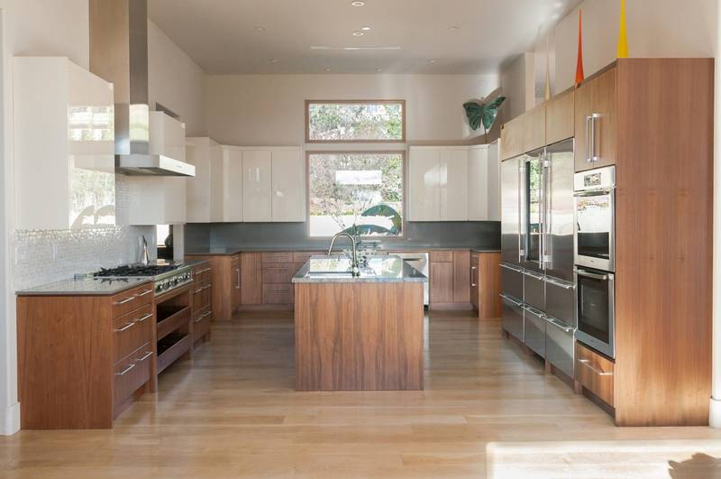 This custom contemporary Kitchen furniture is prepared and shipped to LA (loss Angeles California) we did use PET, sleek look, without handles for upper cabinet, White high gloss combined with natural walnut wood gave a warm feeling, island is covered wit