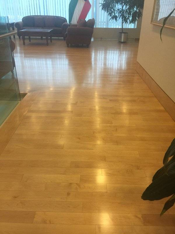 Maple hardwood floors refinished in natural oil based polyurethane for an Embassy