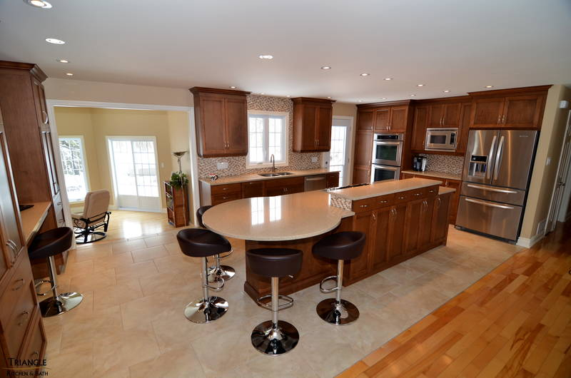 "Combined original kitchen dining room to make this spacious Chef Kitchen with close to 12' long island/bar complete with 42""high lower cabinets at front of island to hide cooktop; quartz counter tops; new access door to backyard; study area between two pa"