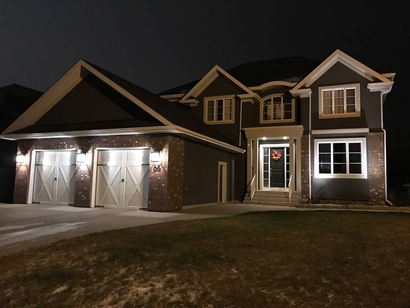 Low voltage lighting transforms this home's curb appeal!